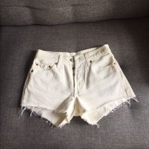 White Levi cutoff denim shorts with button fly